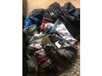 Bundle of men's clothes sizes small to medium coats vest tops sweat shirts