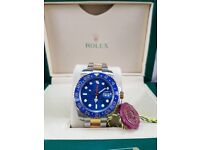 New boxed with papers set two tone bracelet gold case blue face blue bezel Rolex GMT Master II with