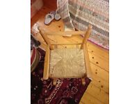 Childs solid pine rocking chair in excellent condition wth coir seat used but in very good condition
