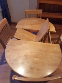 Dining room table and 4 chairs with light swede covering. Light oak.