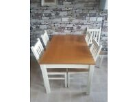 Extending dining table & 5 chairs cream £130 ono
