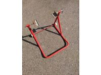 Paddock stand. A few years old but barely used.