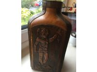 Old Leather Bottle - ingrained prints all round