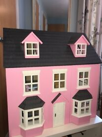 Beautiful dolls house with furniture and six dolls