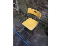 Four plastic chairs - Good condition (2 blue - 2 yellow)