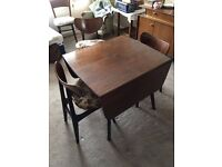 E Gomme butterfly G-Plan extending dining table with chairs.