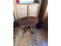 Small mahogany oval pedestal table