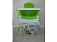 Munchkin child's table booster seat