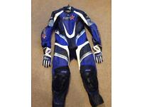 RST one piece race leathers with gloves.