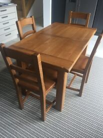 Extending Oak Dining Table and 6 matching chairs