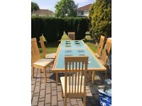 Glass top & real wood extending dining table & 6 chairs in good condition