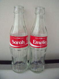 2 empty glass bottles: Share a Coke with Sarah and Share a Coke with Emelio. £3 for both.