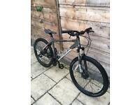 "Carrera Vengeance adult mountain bike 20 inch frame, 26"" Wheels."