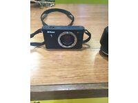 Nikon J 1 plus lens
