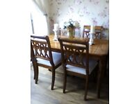 Beautiful solid wood dining table and four chairs