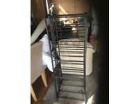 2 black shoe racks, metal and plastic