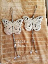 Two large metal wall hanging butterflys