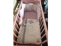 Pink crib mattress and bedding