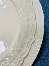 Set of six pale blush china charger plates