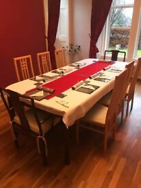 large extending dining table with two carver chairs