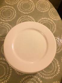 Six large white dinner plates