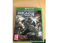 unused copy of Gears of war 4 including download codes for 4 previous gears games