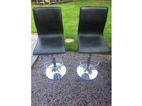 2 black leather and chrome bar stools