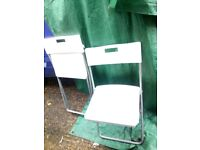 2 x plastic and metal fold up garden chairs