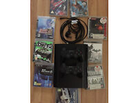 PS3 Super Slim with 9 Games