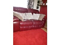 2 x 2 seater leather reclining sofas + 1 matching reclining chair great condition 4 years old
