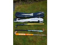 £10 for the lot Hockey sticks and holdalls