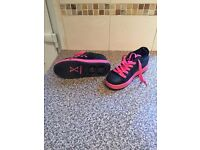 Pink and black sidewalk sparks heelie type trainers. Size 2
