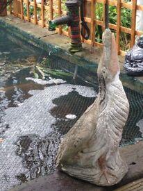 Huge stone very old heron water fountain