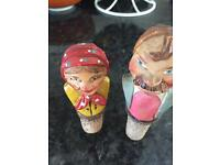 Antique carved wood wine bottle stoppers.