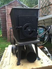 A lovely working woodburner in good condition .