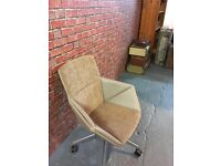 A suede and faux leather swivel office chair