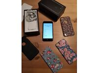 Apple iPhone 7 128gb. Unlocked. Black. With 4 cases & Earphones. Boxed. Still in Apple Warranty.