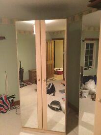 Maple coloured, mirrored door wardrobes.