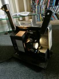 Bell and Howell projector with screen