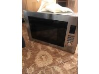 Indesit brand new built in microwave.