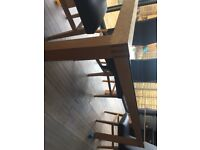 Black glass and wooden 6 sweater dining table