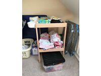 Changing table with white plastic storage boxes