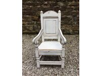 Distressed white child's high back chair.