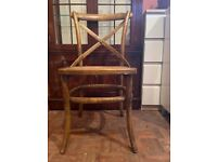 Wooden chair with woven seat area