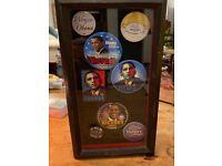 Barack Obama Collectables badges in frame
