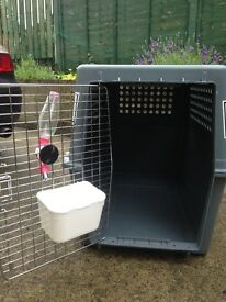 Dog carry box. Dog transport cage. Pet box.