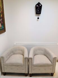 A pair of lovely designer sofas, almost new