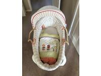 Mamas and papas Moses basket and wooden rocking stand.