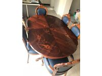 Real Wood dining table + chairs. Good condition