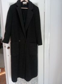 Elegant Ladies calf length all wool coat. A beautiful, warm coat to keep out the winter chills.